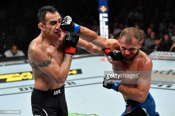 Donald Cerrone and Tony Ferguson exchange punches in their lightweight bout during the UFC 238 event at the United Center on June 8 2019 in Chicago...