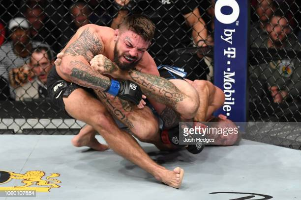 Donald Cerrone attempts to submit Mike Perry in their welterweight bout during the UFC Fight Night event inside Pepsi Center on November 10 2018 in...