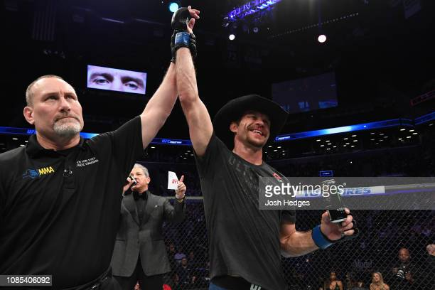 Donald Cerrone celebrates his TKO victory over Alexander Hernandez in their lightweight bout during the UFC Fight Night event at the Barclays Center...