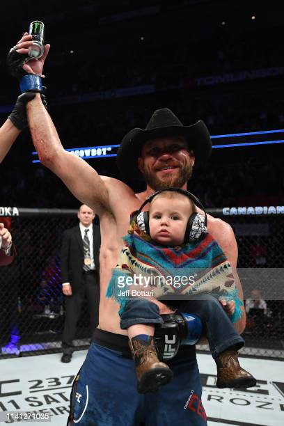 Donald Cerrone celebrates his victory over Al Iaquinta after their lightweight bout during the UFC Fight Night event at Canadian Tire Centre on May 4...