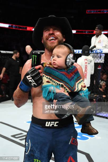 Donald Cerrone celebrates with his son Dacson Danger Cerrone after his victory over Al Iaquinta during the UFC Fight Night event at Canadian Tire...