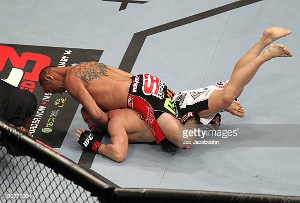 Donald Cerrone defeats Dennis Siver with a rear choke submission during the UFC 137 event at the Mandalay Bay Events Center on October 29 2011 in Las...