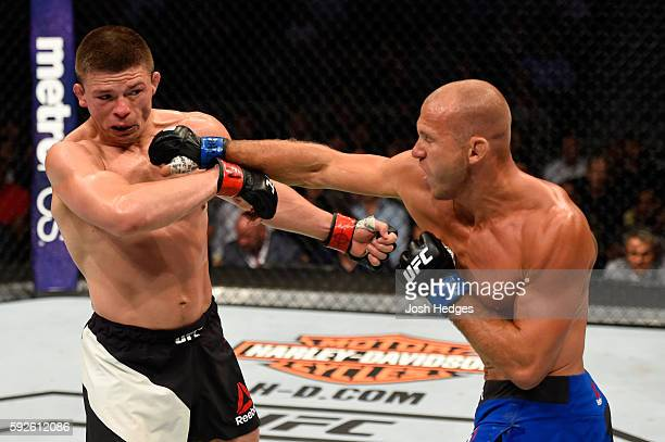 Donald Cerrone fights Rick Story in their welterweight bout during the UFC 202 event at T-Mobile Arena on August 20, 2016 in Las Vegas, Nevada.