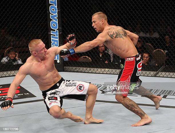 Donald Cerrone follows in with a punch after knocking down Dennis Siver with a kick during the UFC 137 event at the Mandalay Bay Events Center on...