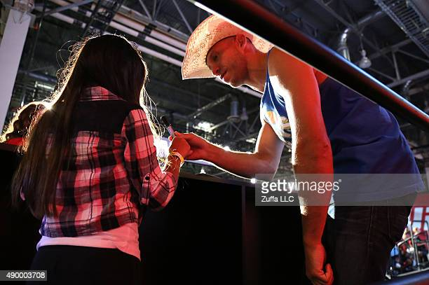 Donald Cerrone interacts with a fan at the UFC Fan Expo in the Sands Expo and Convention Center on July 9 2015 in Las Vegas Nevada