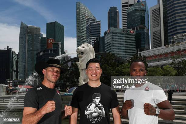 Donald Cerrone, Kevin Chang, UFC Asia Pacific vice president, and Leon Edwards pose for a photo at the Merlion Park, overlooking the financial...