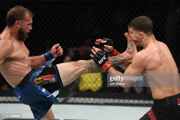 Donald Cerrone kicks Al Iaquinta in their lightweight bout during the UFC Fight Night event at Canadian Tire Centre on May 4 2019 in Ottawa Ontario...