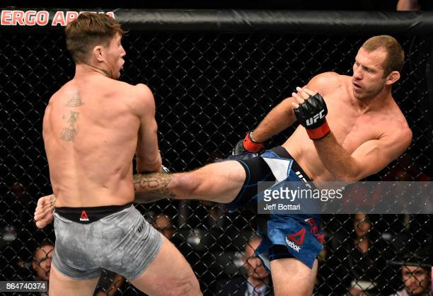 Donald Cerrone kicks Darren Till of England in their welterweight bout during the UFC Fight Night event inside Ergo Arena on October 21 2017 in...