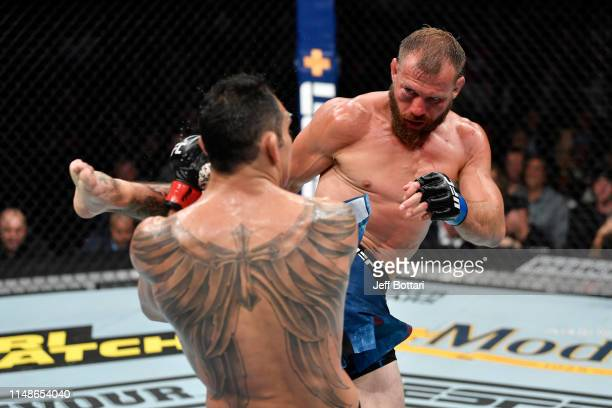 Donald Cerrone kicks Tony Ferguson in their lightweight bout during the UFC 238 event at the United Center on June 8 2019 in Chicago Illinois