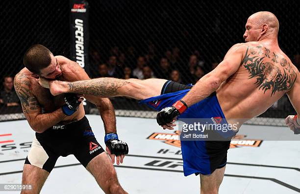 Donald Cerrone knocks out Matt Brown with a kick to the head in their welterweight bout during the UFC 206 event inside the Air Canada Centre on...