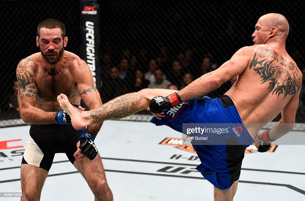 Donald Cerrone knocks out Matt Brown with a kick to the head in their welterweight bout during the UFC 206 event inside the Air Canada Centre on December 10, 2016 in Toronto, Ontario, Canada.