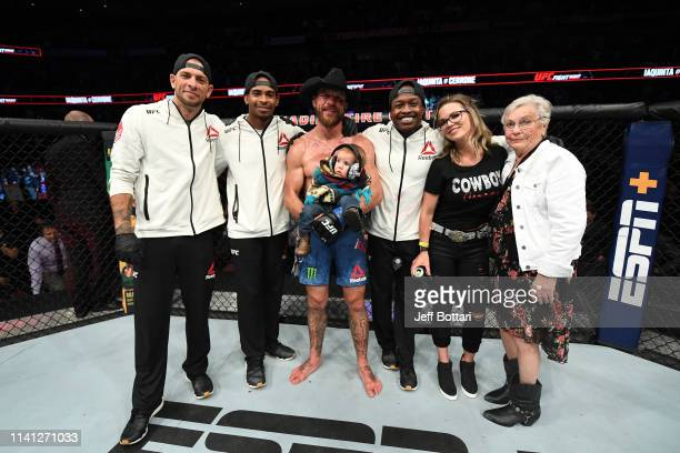 Donald Cerrone poses for a photo with his family and team after his victory over Al Iaquinta during the UFC Fight Night event at Canadian Tire Centre...