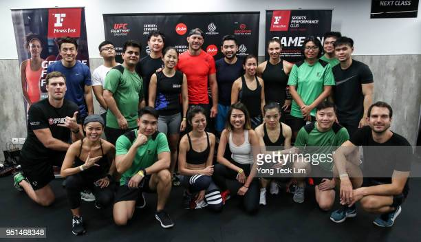 Donald Cerrone poses for photos with participants of an MMA seminar on April 26 2018 in Singapore