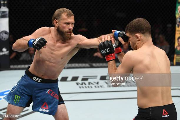 Donald Cerrone punches Al Iaquinta in their lightweight bout during the UFC Fight Night event at Canadian Tire Centre on May 4 2019 in Ottawa Ontario...