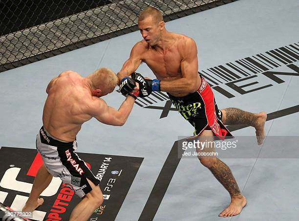 Donald Cerrone punches Dennis Siver during the UFC 137 event at the Mandalay Bay Events Center on October 29, 2011 in Las Vegas, Nevada.