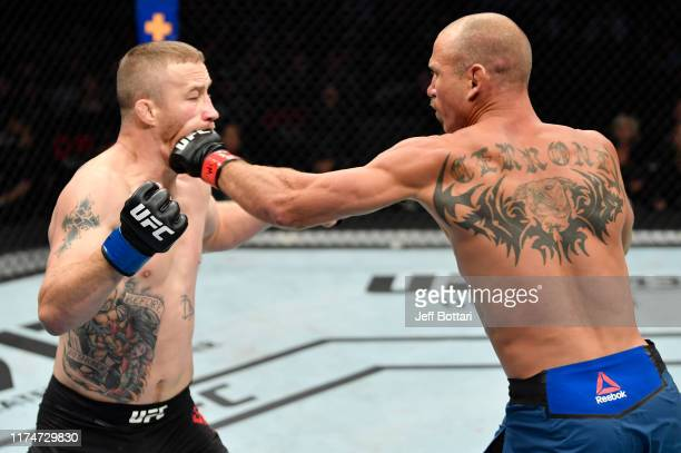 Donald Cerrone punches Justin Gaethje in their lightweight bout during the UFC Fight Night event at Rogers Arena on September 14 2019 in Vancouver...