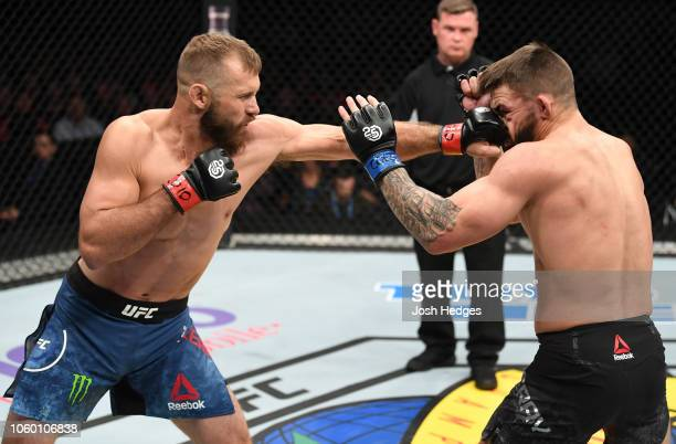 Donald Cerrone punches Mike Perry in their welterweight bout during the UFC Fight Night event inside Pepsi Center on November 10 2018 in Denver...
