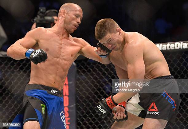 Donald Cerrone punches Rick Story in their welterweight bout during the UFC 202 event at T-Mobile Arena on August 20, 2016 in Las Vegas, Nevada.