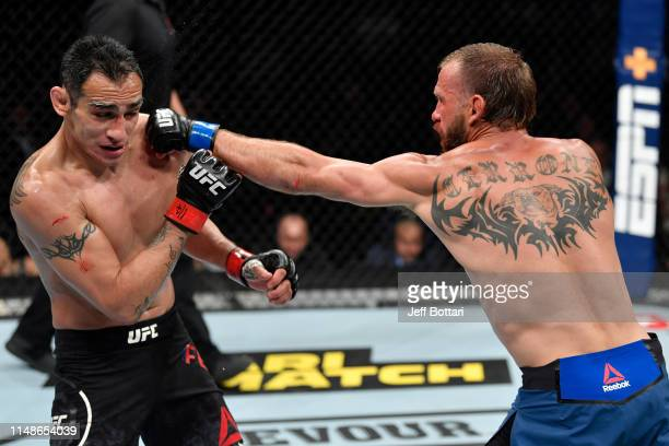 Donald Cerrone punches Tony Ferguson in their lightweight bout during the UFC 238 event at the United Center on June 8 2019 in Chicago Illinois