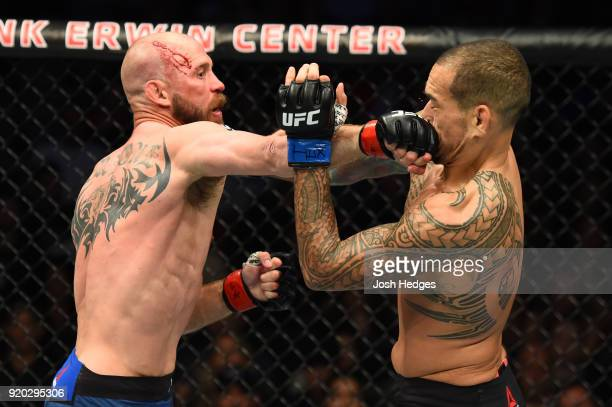 Donald Cerrone punches Yancy Medeiros in their welterweight bout during the UFC Fight Night event at Frank Erwin Center on February 18 2018 in Austin...