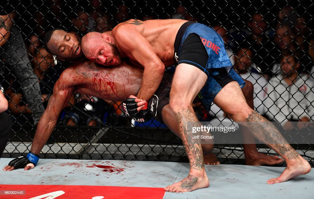 Donald Cerrone takes down Leon Edwards of Jamaica in their welterweight bout during the UFC Fight Night event at the Singapore Indoor Stadium on June 23, 2018 in Singapore.