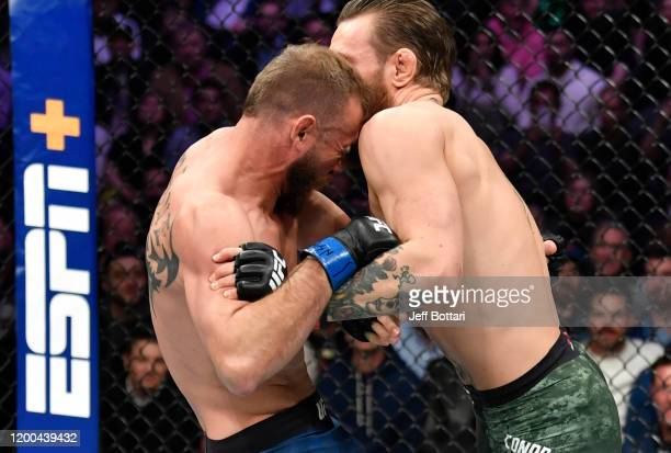 Donald Cerrone wrestles Conor McGregor of Ireland in their welterweight fight during the UFC 246 event at T-Mobile Arena on January 18, 2020 in Las...