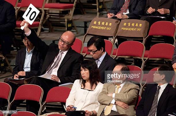 Donald Choi managing director of Nan Fung Development makes a bid during a government land auction in Hong Kong China on Tuesday May 11 2010 Hong...