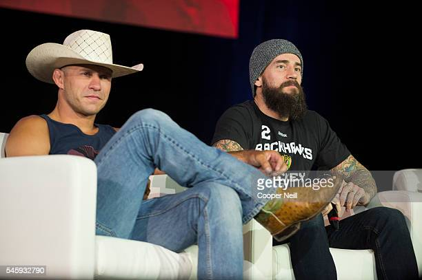 Donald 'Cowboy' Cerrone and CM Punk look on during UFC Fan Expo Day 3 at the Las Vegas Convention Center on July 10 2016 in Las Vegas Nevada