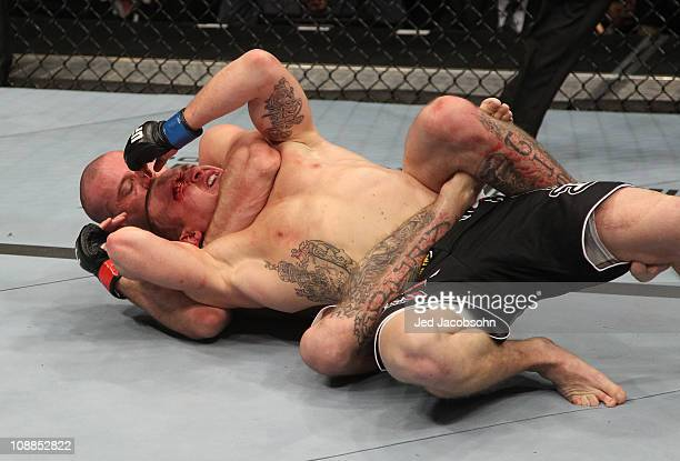 Donald Cowboy Cerrone defeats Paul Kelly by rear choke submission during their lightweight bout at UFC 126 at the Mandalay Bay Events Center on...