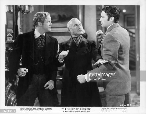 Donald Crisp breaks up a fight between a man and Gregory Peck in a scene from the film 'The Valley Of Decision', 1945.
