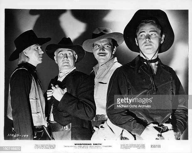Donald Crisp, Robert Preston and Alan Ladd standing together wearing cowboy hats in a scene from the film 'Whispering Smith', 1948.