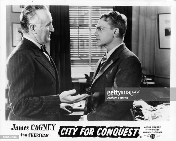 Donald Crisp talking to James Cagney in a scene from the film 'City For Conquest', 1940.