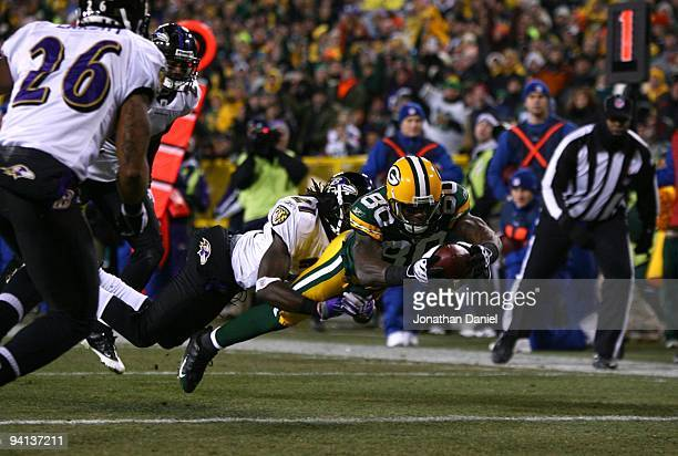 Donald Driver of the Green Bay Packers dives for an 8-yard touchdown reception in the second quarter against Lardarius Webb of the Baltimore Ravens...