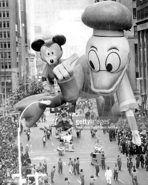 Donald Duck sports limp wing after brush with tree branchSidekick Mickey Mouse who's marching behind him made a debut appearance also at Macy's...