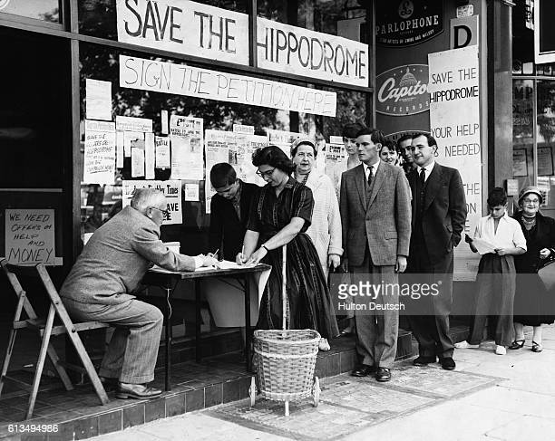 Donald Dutton collects signatures for a petition to prevent the Hippodrome Theatre at Golders Green in London from being demolished