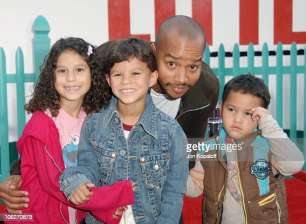 Donald Faison and children during Chicken Little Los Angeles Premiere Arrivals at El Capitan Theater in Hollywood California United States