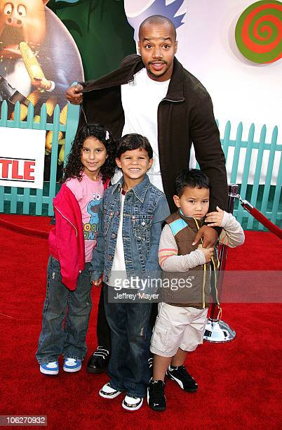 Donald Faison and children during Disney's Chicken Little Los Angeles Premiere Arrivals at El Capitan in Hollywood California United States