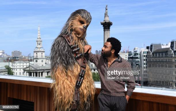 Donald Glover and Chewbacca attend Solo A Star Wars Story photocall on May 18 2018 in London United Kingdom