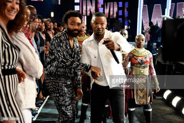 Donald Glover and host Jamie Foxx attend the 2018 BET Awards at Microsoft Theater on June 24 2018 in Los Angeles California
