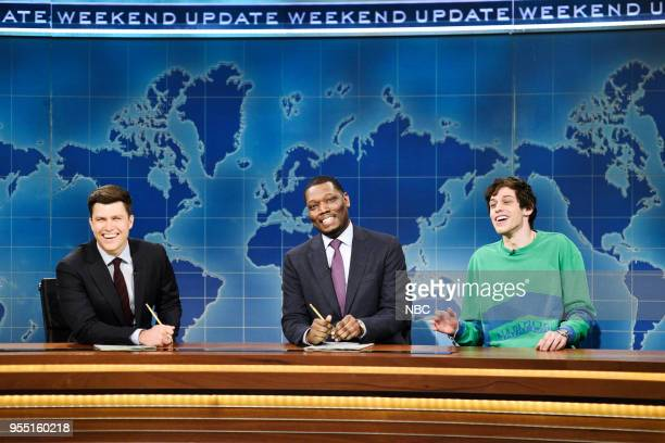 LIVE Donald Glover Episode 1744 Pictured Colin Jost Michael Che Pete Davidson during 'Weekend Update' in Studio 8H on Saturday May 5 2018