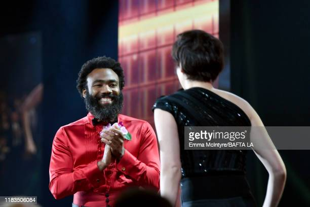 Donald Glover presents the Britannia Award for British Artist of the Year to Phoebe WallerBridge onstage during the 2019 British Academy Britannia...