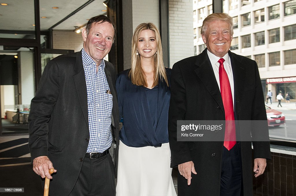 Donald Graham, Ivanka Trump and Donald Trump pose for a photo during a forum on 'Washington real estate -- including plans to renovate the landmark Old Post Office on Pennsylvania Avenue and views on property values and trends in Washington.' at Washington Post on April 10, 2013 in Washington, DC.