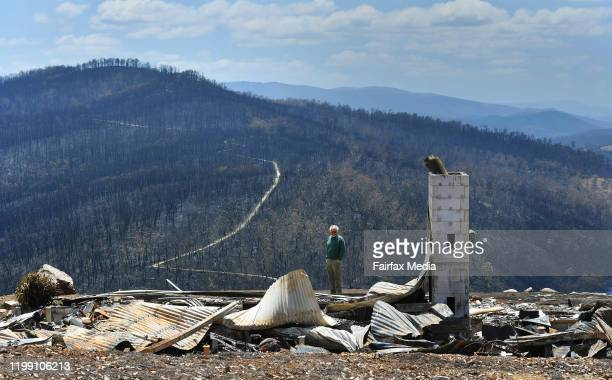 Donald Graham stands on the ruins of his home that burned in the Gippsland bushfires near Buchan in Victoria, January 11, 2020. He and his wife...