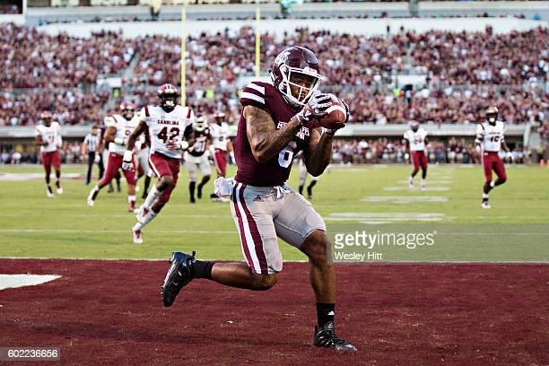 Donald Gray of the Mississippi State Bulldogs catches a pass for a touchdown in the first half during a game against the South Carolina Gamecocks at...