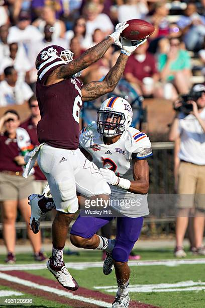 Donald Gray of the Mississippi State Bulldogs catches a pass while being covered by Ralpheal Green of the Northwestern State Demons at Davis Wade...