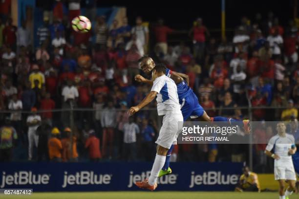 Donald Guerrier of Haiti vies for the ball with Josue Quijano of Nicaragua during the first of two match to define the last qualified to the 2017...
