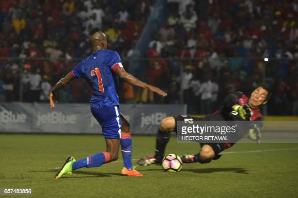 Donald Guerrier of Haiti vies for the ball with Justo Llorente of Nicaragua during the first of two match to define the last qualified to the 2017...