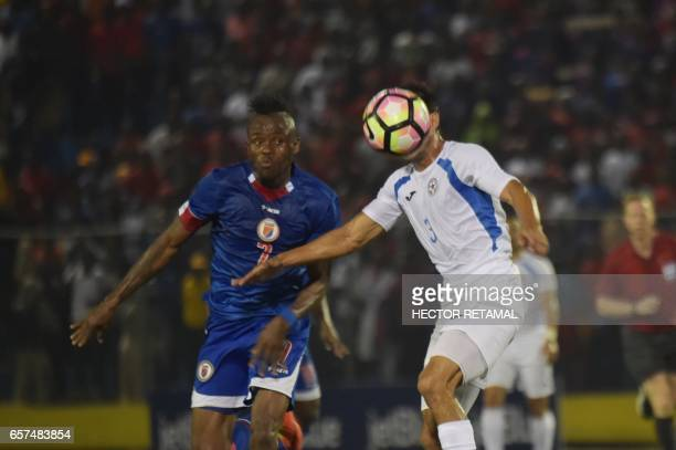 Donald Guerrier of Haiti vies for the ball with Manuel Rosas of Nicaragua during the first of two match to define the last qualified to the 2017 Gold...