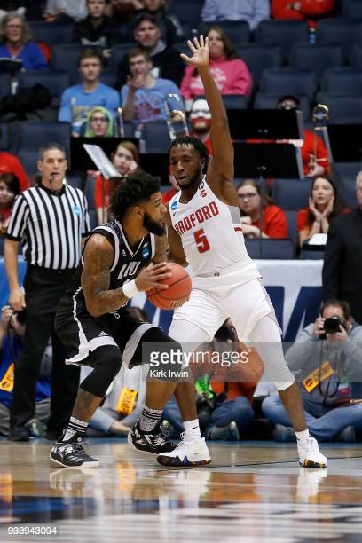 Donald Hicks of the Radford Highlanders defends against Joel Hernandez of the LIU Brooklyn Blackbirds during the game at UD Arena on March 13 2018 in...