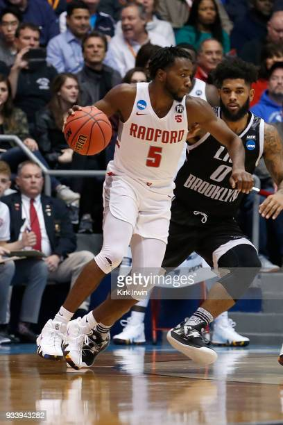 Donald Hicks of the Radford Highlanders drives the ball against Joel Hernandez of the LIU Brooklyn Blackbirds during the game at UD Arena on March 13...